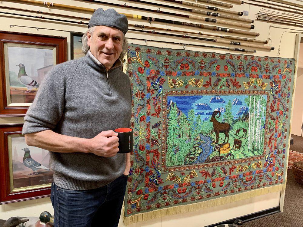 Museum founder Jim Shockey shows off a prized Siberian wedding blanket.