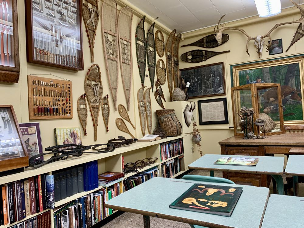 A snowshoe collection in a former classroom filled with rare books.